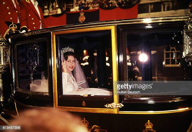 Princess Margaret waves from the Royal Coach during her wedding to Lord Snowdon in London.