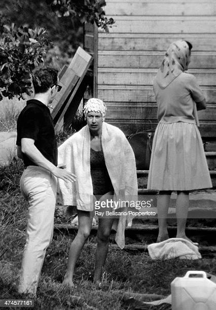 Princess Margaret wearing a swimming costume and wrapped in a towel with friends at Sunninghill Park Windsor on 18th July 1964 This image is one of a...