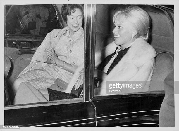 Princess Margaret with actress Britt Ekland in the back of a Rolls Royce car on their way to a theatre in London April 22nd 1965