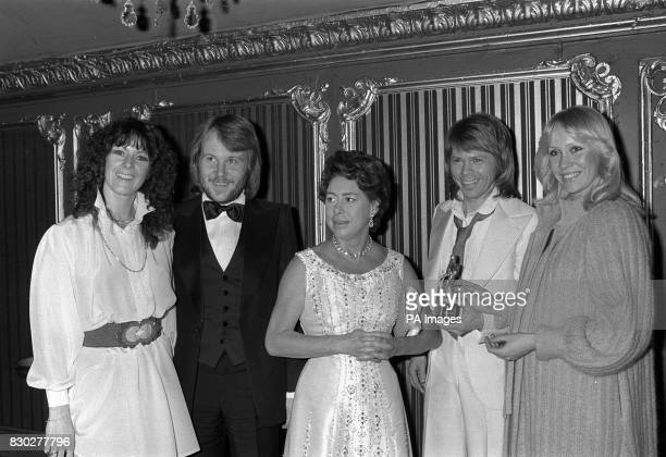 Princess Margaret with four members of the Swedish pop group Abba afther she had presented them with the CarlAlan group Award for 1977 at the Lyceum...