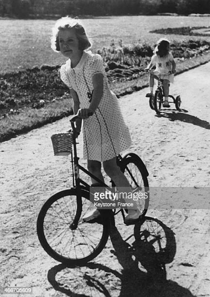 Princess Margaretha and her sister Princess Desiree, daughters of Crownprince Gustaf Adolf and of Princess Sibylla, cycle in the park of Haga Castle...