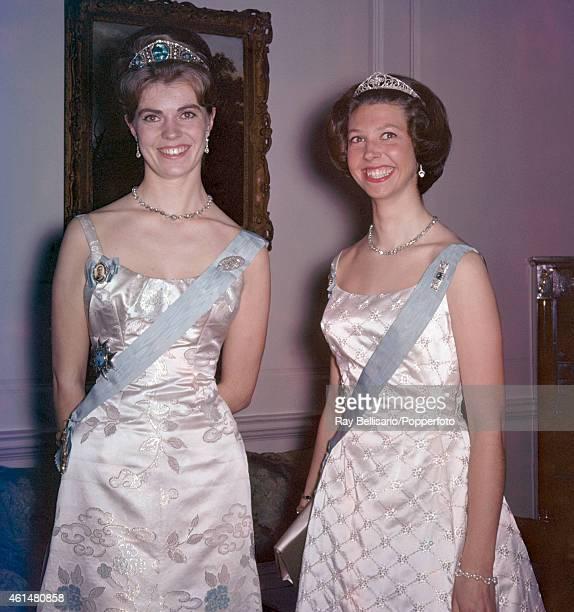 Princess Margaretha and Princess Desiree of Sweden at a dinner party at Windsor, circa 1964.
