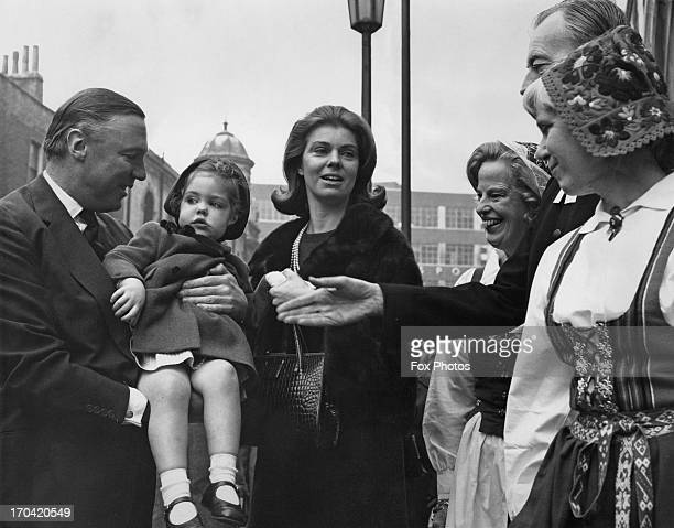 Princess Margaretha of Sweden and her husband John Ambler holding their daughter Sibylla Louise Ambler, are greeted by women in Swedish National...