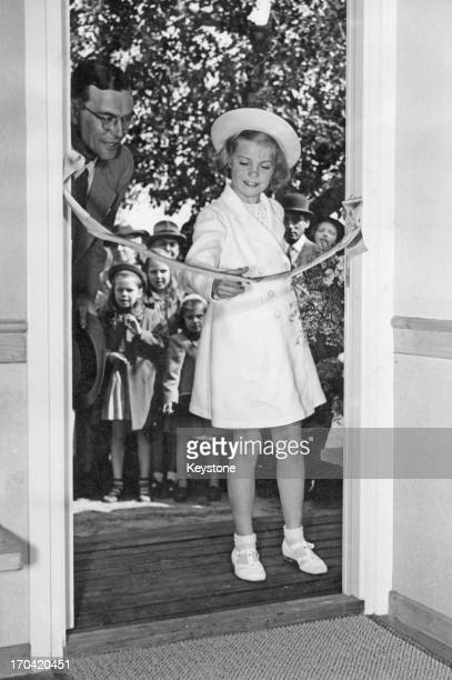 Princess Margaretha of Sweden cuts the ribbon at the opening ceremony for 'Kings Own Cottage' 1943
