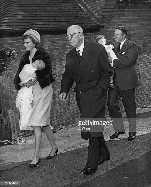 Princess Margaretha of Sweden holding her son Charles Edward Ambler walking with Gustaf VI Adolf of Sweden and husband John Ambler behind holding...