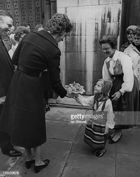Princess Margaretha of Sweden is given a bouquet by Karin Geidler at the official opening of the traditional Swedish Christmas Fair at the Swedish...