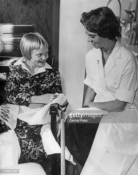 Princess Margaretha of Sweden is working as an assistant in the therapeutic section of a Stockholm hospital, 14th November 1958. In this picture the...