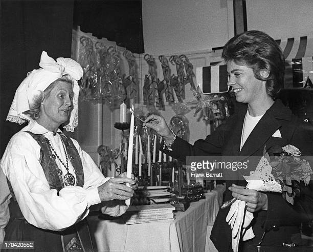 Princess Margaretha of Sweden lights a candle to mark the official opening of the annual Swedish Christmas Fair at the Swedish Church Hall,...