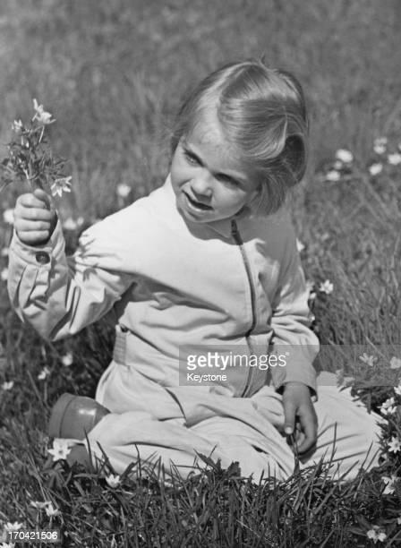 Princess Margaretha of Sweden picking flowers in Haga Park, Sweden, May 1939.