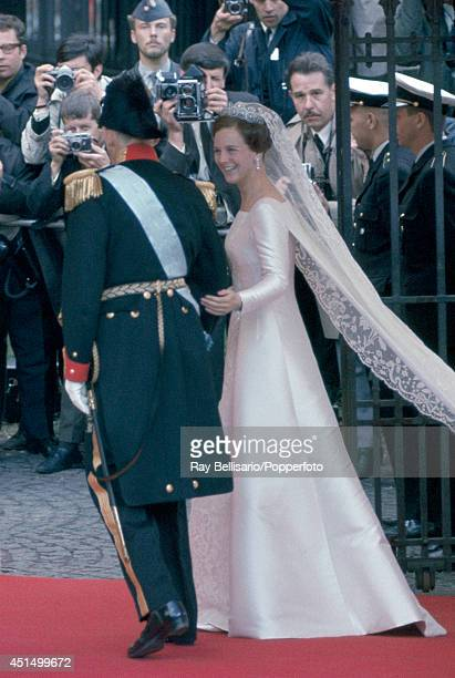 Princess Margarethe of Denmark on the arm of her father King Frederick IX as she enters the Church of Holmen in Copenhagen on her wedding day on 10th...