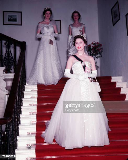 1955 Princess Margaret's Caribbean Tour Princess Margaret is pictured descending the grand staircase at her first State Banquet held in Government...