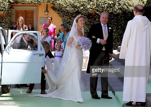Princess Maria Carolina de Bourbon-Parme is greeted by the priest on June 16, 2012 as she arrives with her brother Carlos Javier for her royal...