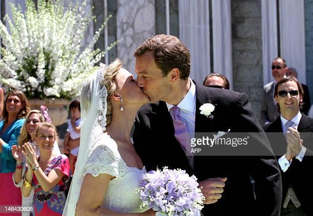 Princess Maria Carolina of Bourbon-Parma kisses her husband Albert Brenninkmeijer outside San Miniato al Monte Basilica in Florence following the...