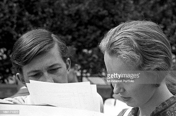 Princess Maria Gabriella of Savoy and Robert Matossian read carefully the instructions of the car rally which they are preparing to participate in...