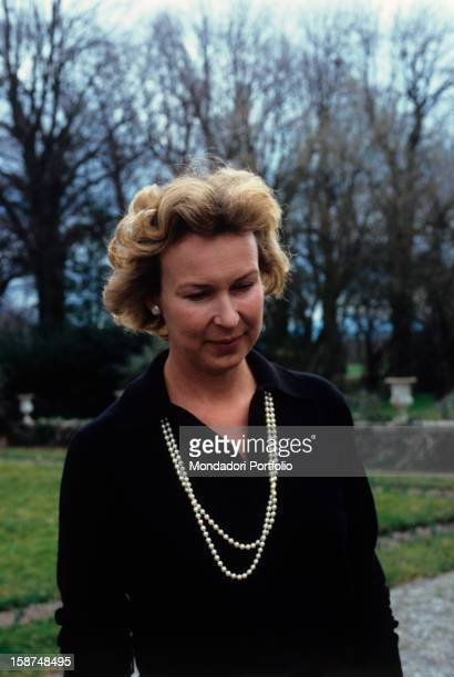 Princess Maria Gabriella of Savoy Savoyard princess and noted historian of Italy with her eyes looking downwards is walking in a somptuous garden...