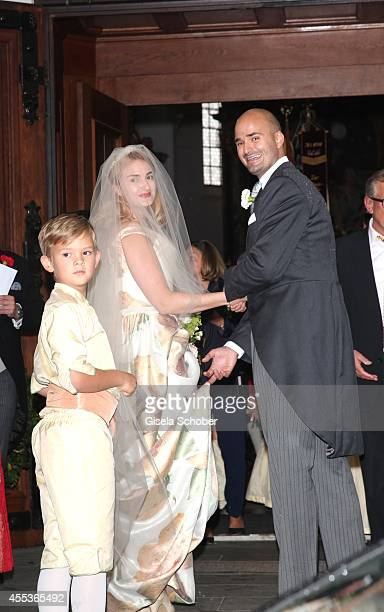 Princess Maria Theresia von Thurn and Taxis and her brother Prince Albert von Thurn und Taxis attend the wedding of Maria Theresia Princess von Thurn...