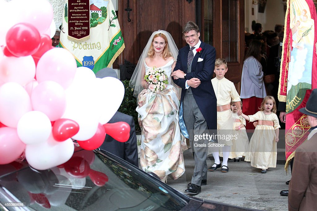 Princess Maria Theresia von Thurn und Taxis and her husband Hugo Wilson, Valentin Schoenburg Glauchau attend the wedding of Maria Theresia Princess von Thurn und Taxis and Hugo Wilson at St. Joseph Church in Tutzing on September 13, 2014 in Tutzing, Germany.