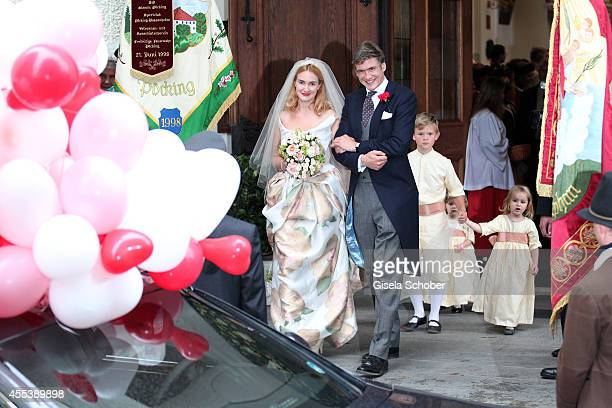 Princess Maria Theresia von Thurn und Taxis and her husband Hugo Wilson Valentin Schoenburg Glauchau attend the wedding of Maria Theresia Princess...