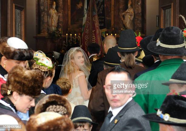 Princess Maria Theresia von Thurn und Taxis is being escorted by her brother Albert to the wedding altar at the church of Saint Joseph in Tutzingen...