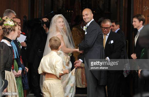 Princess Maria Theresia von Thurn und Taxis is led to the altar of the Church of St Joseph by her brother Prince Albert in Tutzing Germany 13...
