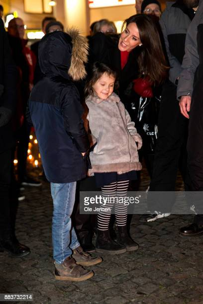 Princess Marie of Denmark and her children Princess Athena and Prince Henrik lights a candle in remembrance of World AIDS Day at Gammel Torv on...