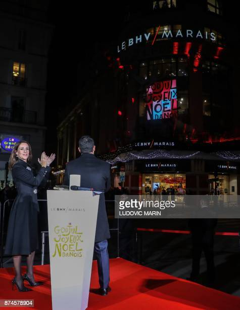 Princess Marie of Denmark applauds as she stands alongside BHV Director Alexandre Liot at BHV Marais in Paris on November 15 after she turned on the...