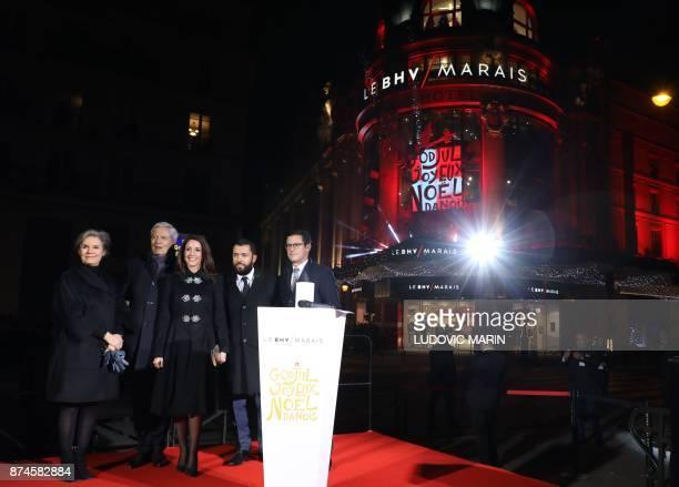Princess Marie of Denmark stands alongside BHV Director Alexandre Liot President of boards of directors Philippe Houze director of Galeries Lafayette...