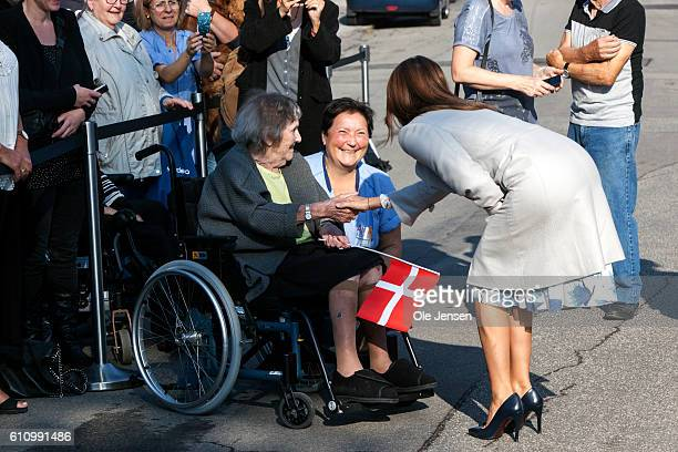 Princess Marie of Denmark takes her time saying hello to spectators during her attendance at the opening ceremony of old ceramic art company Kähler's...