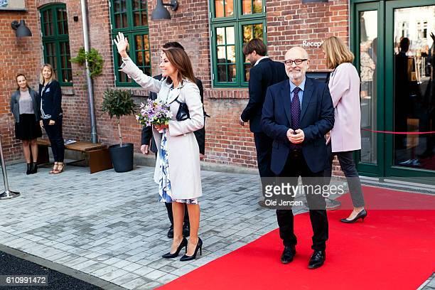 Princess Marie of Denmark waves to spectators at the opening ceremony of ceramic art company Kähler's new head quarter and historic exhibition in...
