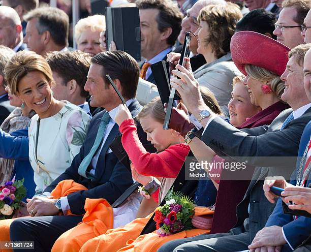 Princess Marilene Prince Maurits Princess Ariane Crown Princess CatharinaAmalia Queen Maxima and King WillemAlexander of The Netherlands use tablets...