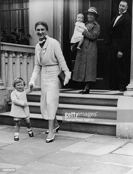 Princess Marina Duchess of Kent holds the hand of her son Prince Edward as they leave her house in Belgrave Square London A nanny carries Princess...