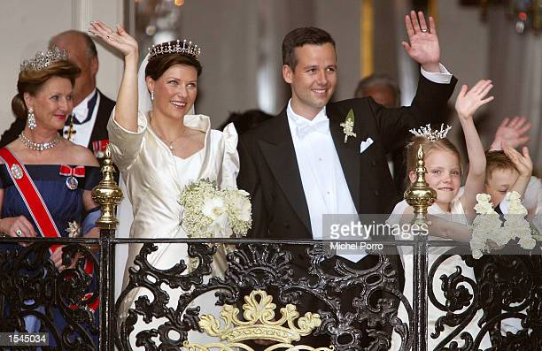 Princess Martha Louise of Norway and writer Ari Behn wave from the balcony of the Stiftsgarden Palace after their wedding at the Nidaros Cathedral...