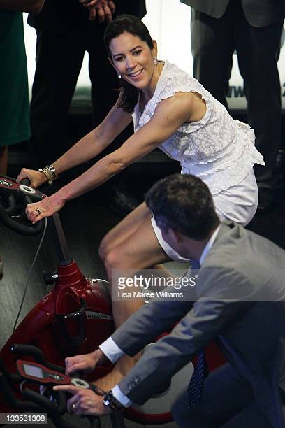 Princess Mary and Prince Frederik of Denmark test a bicycle display during the opening of 'Curating Cities SydneyCopenhagen' at Customs House on...