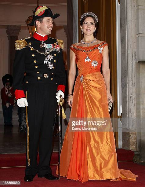 Princess Mary of Denmark and Crown Prince Frederik of Denmark arrive at a New Year's Banquet hosted by Queen Margrethe of Denmark at Christian VII's...