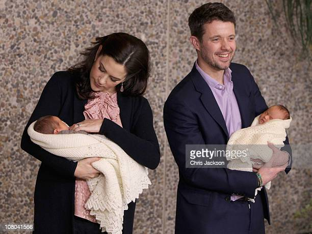 Princess Mary of Denmark and Crown Prince Frederik of Denmark hold their newborn baby twins as they leave the Rigshospitalet on January 14 2011 in...