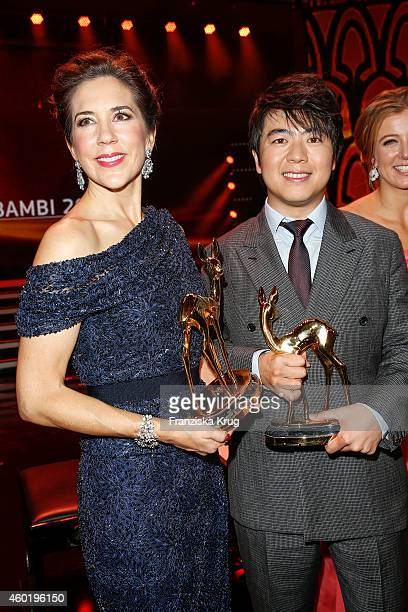 Princess Mary of Denmark and Lang Lang pose with their awards after the Bambi Awards 2014 show on November 14 2014 in Berlin Germany