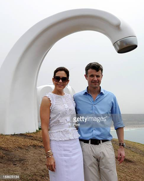 Princess Mary of Denmark and Prince Frederik of Denmark admire the view near the fibreglass artwork 'Who Left The Tap Running' by Australian artist...