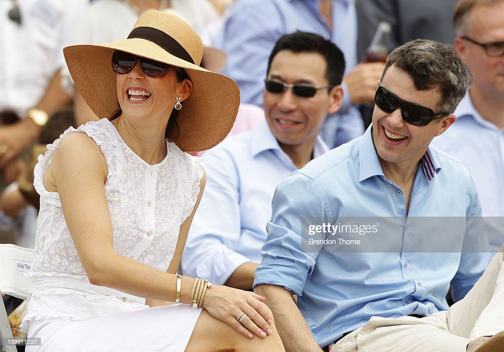 Princess Mary of Denmark and Prince Frederik of Denmark share a joke during their visit to 'Sculpture by the Sea' on November 20, 2011 in Sydney, Australia.