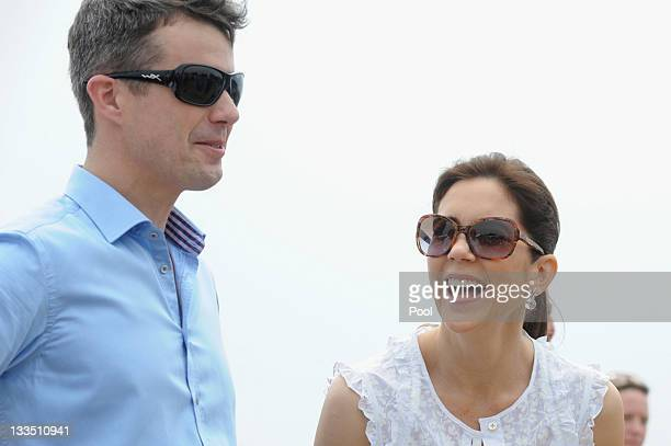 Princess Mary of Denmark and Prince Frederik of Denmark smile during a visit to Sculpture by the Sea on November 20 2011 in Sydney Australia Princess...