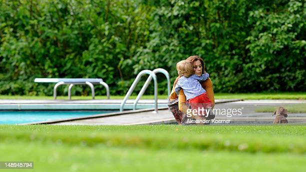 Princess Mary of Denmark and Prince Vincent Frederik Minik Alexander pose during a photocall for the Royal Danish family at their summer residence of...