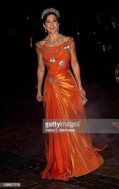 Princess Mary of Denmark arrives at a New Year's Banquet hosted by Queen Margrethe of Denmark at Christian VII's Palace on January 1, 2013 in...