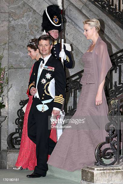 Princess Mary of Denmark Crown Prince Frederik of Denmark and Princess Charlene of Monaco depart from the wedding of Princess Madeleine of Sweden and...