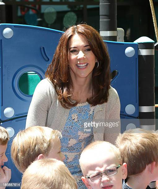 Princess Mary of Denmark interacts with children at the Children's Hospital during a visit to the Australian Twin Registry on October 26 2013 in...