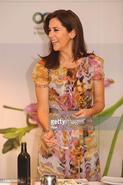 Princess Mary of Denmark is given a cooking demonstration by Aria Resturant chef Matt Moran and Danish chef Rasmus Kofoed at the Hotel Sofitel...