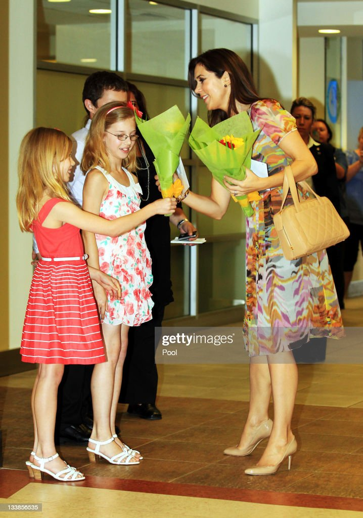 Princess Mary of Denmark (R) meets with (L - R) Isabella Moon, aged 8, Mathew Moon (behind), aged 12 and Saskia Moon, aged 10, as she visits the newly re-named Crown Princess Mary Cancer Centre Westmead on November 21, 2011 in Sydney, Australia. Princess Mary and Prince Frederik are on their first official visit to Australia since 2008. The Royal visit begins in Sydney, before heading to Melbourne, Canberra and Broken Hill.
