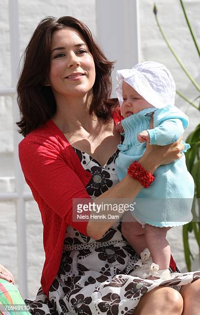 Princess Mary of Denmark poses with her daughter Princess Isabella at a photocall for the Royal Danish family at their summer residence of Grasten...