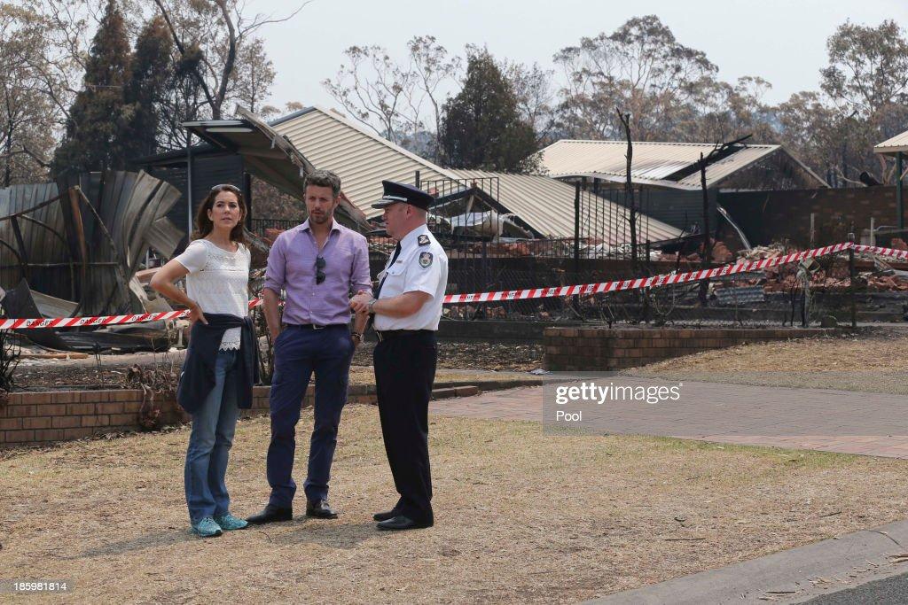 Princess Mary of Denmark, Prince Frederik of Denmark and NSW RFS Commissioner Shane Fitzsimmons speak during a tour of bush fire devastation October 27, 2013 in Winmalee, Australia. Prince Frederik and Princess Mary will visit Sydney for five days and will attend events to celebrate the 40th anniversary of the Sydney Opera House and the Danish architect who designed the landmark, Jorn Utzen.