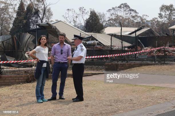 Princess Mary of Denmark, Prince Frederik of Denmark and NSW RFS Commissioner Shane Fitzsimmons speak during a tour of bush fire devastation October...