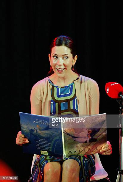 """Princess Mary of Denmark reads """"The Ugly Duckling"""", a Hans Christian Andersen fairytale, to ill children during a visit to Westmead childrens..."""