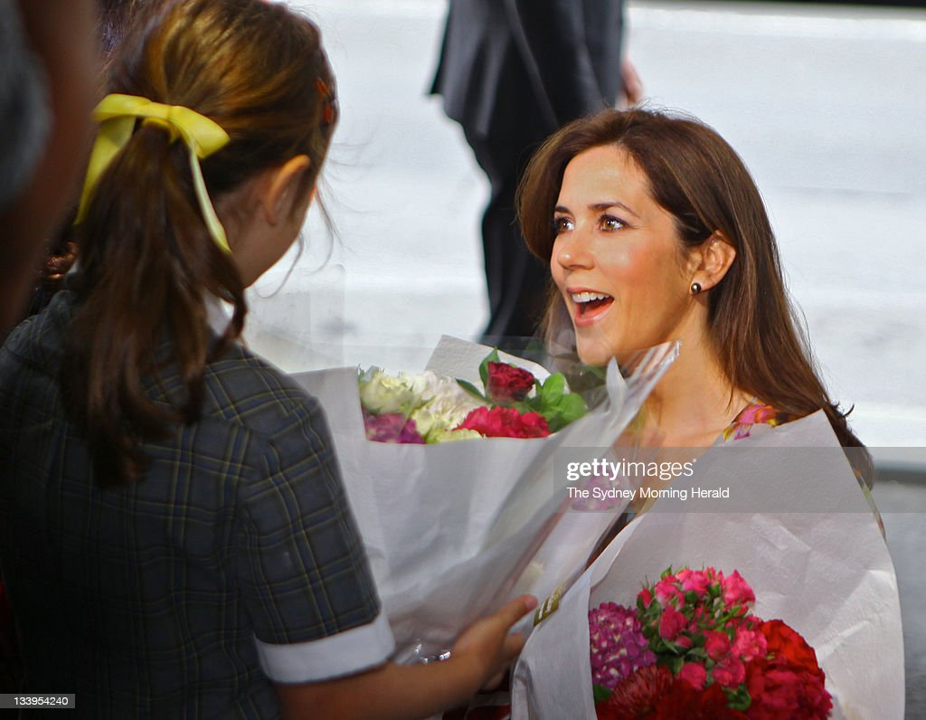 Princess Mary of Denmark of Denmark receives flowers from a school girl at the Sofitel Hotel on November 21, 2011 in Sydney, Australia. (Photo by Brendan Esposito/The Sydney Morning Herald/Fairfax Media via Getty Images).